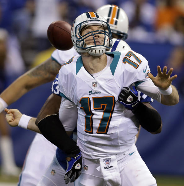 Miami Dolphins quarterback Ryan Tannehill loses the ball as he's hit by Indianapolis Colts outside linebacker Dwight Freeney during the first half of an NFL football game in Indianapolis, Sunday, Nov. 4, 2012. The Dolphins recovered the ball. (AP Photo/Darron Cummings)