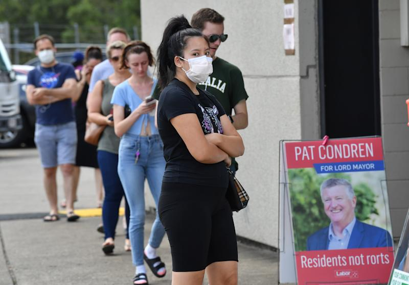 Voters are seen lined up at the Coorparoo pre-polling booth for the Brisbane City Council elections on Wednesday. Source: AAP