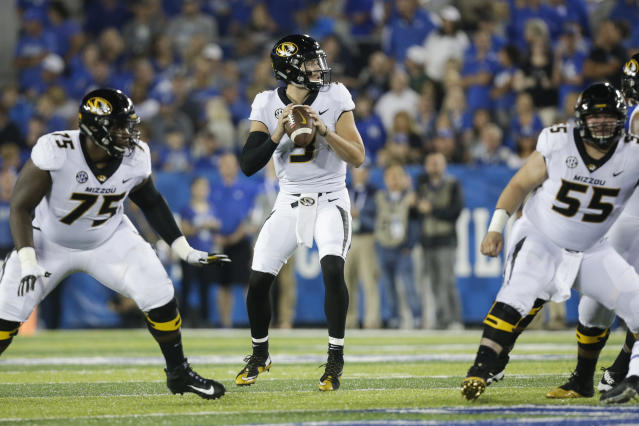 Missouri quarterback Drew Lock looks for a receiver during the first half of an NCAA college football game against Kentucky Saturday, Oct. 7, 2017, in Lexington, Ky. (AP Photo/David Stephenson)