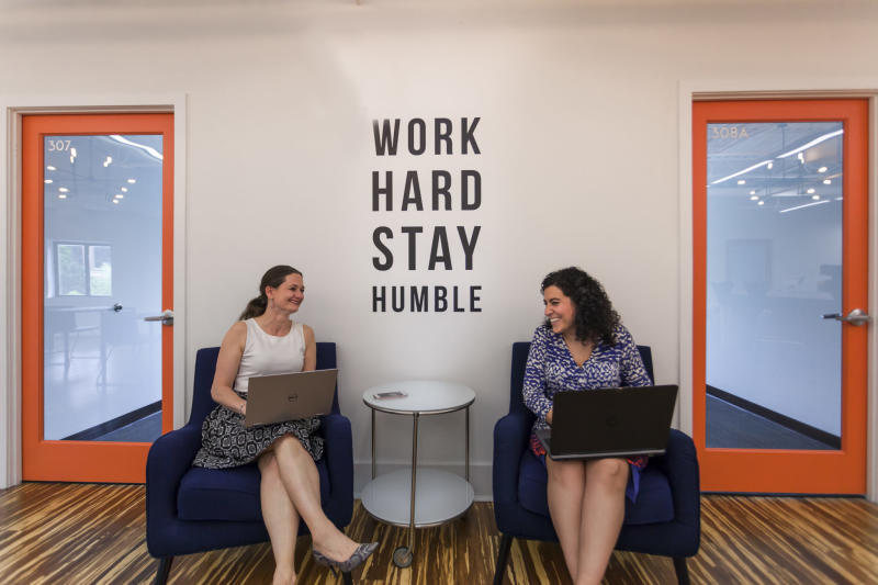 Two women at Novel Coworking's office in Alexandria, Va. Photo credit: Yale Gurney.