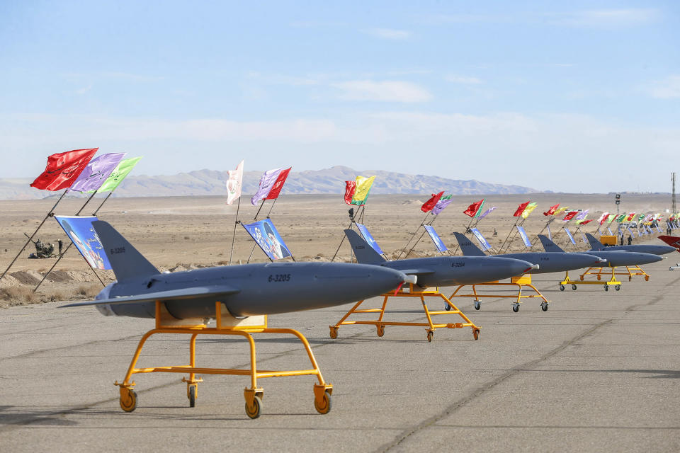 In this photo released on Tuesday, Jan. 5, 2021 by the Iranian army, drones are displayed prior to a drill, in an undisclosed location in Iran. The Iranian military began a wide-ranging, two-day aerial rill in the country's north, state media reported, featuring combat and surveillance unmanned aircraft, as well as naval drones dispatched from vessels in Iran's southern waters. (Iranian Army via AP)