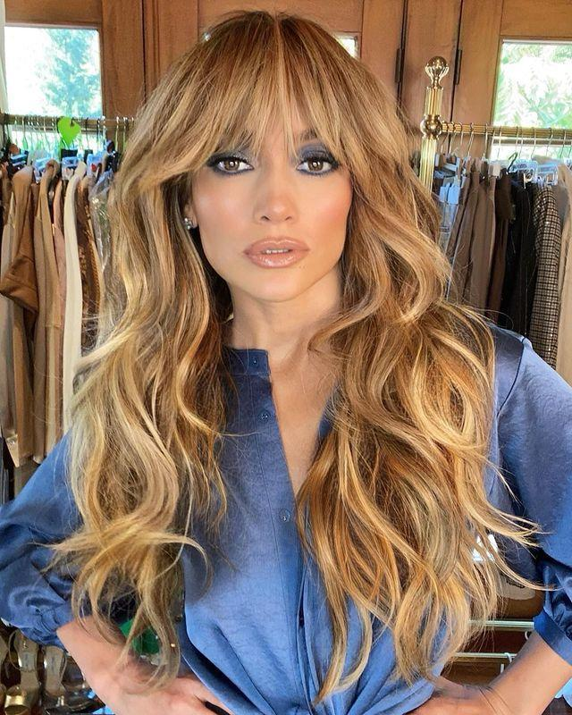 """<p>J Lo turned to A-list hairstylist and her go-to man for a hair transformation, Chris Appleton, for a brand new boho look that's all about the 70s shaggy fringe. The singer looked seriously epic with exta long golden waves and a full messy fringe to complement her groovy blue eyeshadow.</p><p><a href=""""https://www.instagram.com/p/CGTNeWyhe93/?utm_source=ig_embed&utm_campaign=loading"""" rel=""""nofollow noopener"""" target=""""_blank"""" data-ylk=""""slk:See the original post on Instagram"""" class=""""link rapid-noclick-resp"""">See the original post on Instagram</a></p>"""