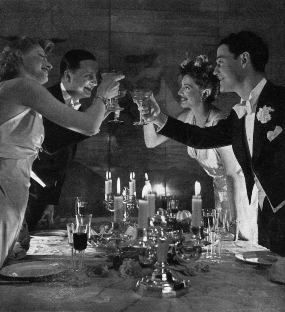 """<p>Toasts were a standout part of any mid-century party. It wasn't limited to just the host, so it wasn't uncommon for more than one person to raise a glass throughout the night with <a href=""""https://www.huffpost.com/entry/1960-cocktail-party_n_6793908"""" data-ylk=""""slk:either a funny limerick"""" class=""""link rapid-noclick-resp"""">either a funny limerick</a> or a sincere thanks.</p>"""