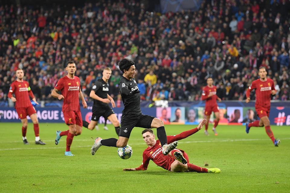 SALZBURG, AUSTRIA - DECEMBER 10: Andy Robertson of Liverpool tackles Takumi Minamino of Red Bull Salzburg during the UEFA Champions League group E match between RB Salzburg and Liverpool FC at Red Bull Arena on December 10, 2019 in Salzburg, Austria. (Photo by Michael Regan/Getty Images)