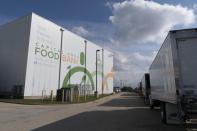 The warehouse for The Capital Area Food Bank is seen by a fleet of trucks, Tuesday, Oct. 5, 2021, in Washington. (AP Photo/Jacquelyn Martin)