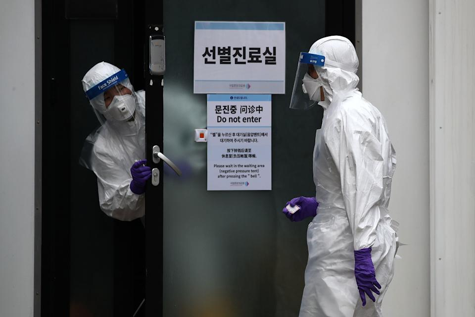 """SEOUL, SOUTH KOREA - FEBRUARY 24: A disinfection professional wears protective gear spray anti-septic solution against the coronavirus (COVID-19) at a National Assembly on February 24, 2020 in Seoul, South Korea. The National Assembly called off its plenary session and temporarily closed its buildings after it was learned that a coronavirus patient attended a parliamentary forum last week. Government has raised the coronavirus alert to the """"highest level"""" as confirmed case numbers keep rising. Government reported 231 new cases of the coronavirus (COVID-19) bringing the total number of infections in the nation to 833, with the potentially fatal illness spreading fast across the country. (Photo by Chung Sung-Jun/Getty Images) (Photo: Chung Sung-Jun via Getty Images)"""