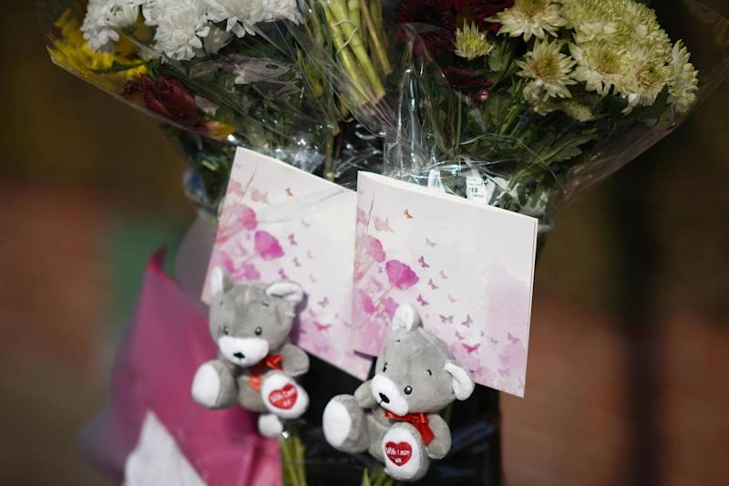Floral tributes are left near the scene (Getty Images)