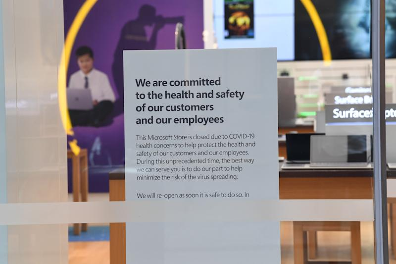 A sign informing customers that the Microsoft store is closed on Pitt Street mall on March 21, 2020 in Sydney, Australia. (Photo: James D. Morgan via Getty Images)