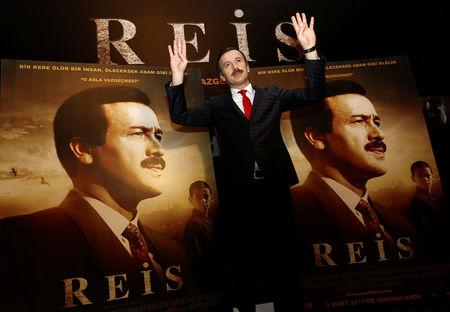 """Actor Reha Beyoglu, who portrays Turkish President Tayyip Erdogan in a biopic titled """"Reis"""", or """"Chief"""", poses for photographers during a gala screening of the movie in Istanbul, Turkey, February 26, 2017. Picture taken February 26, 2017. REUTERS/Murad Sezer"""