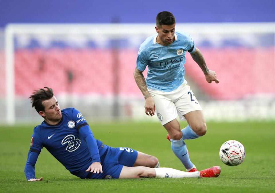 Chelsea's Ben Chilwell (left) and Manchester City's Joao Cancelo battle for the ball during the FA Cup semi final match at Wembley Stadium, London. Picture date: Saturday April 17, 2021.