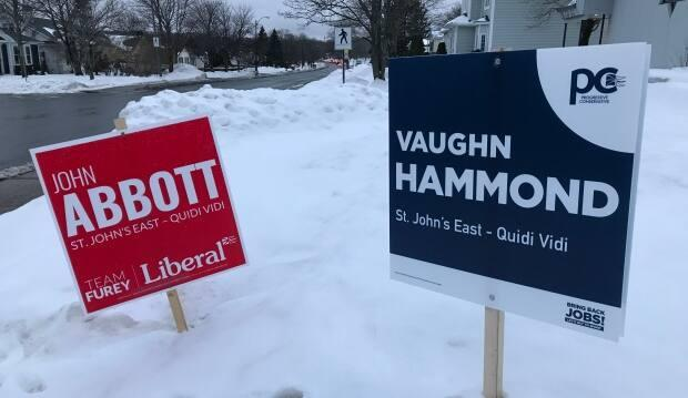 These campaign signs in St. John's East-Quidi Vidi offer some insight into how the two main political parties in Newfoundland and Labrador are promoting their leaders. The Liberals prominently display the slogan 'Team Furey' on campaign signs, while there's no mention of PC Party Leader Ches Crosbie on this sign promoting candidate Vaughn Hammond.