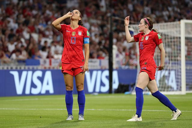 "<a class=""link rapid-noclick-resp"" href=""/ncaaf/players/292082/"" data-ylk=""slk:Alex Morgan"">Alex Morgan</a> sipped some imaginary tea after scoring the USWNT's second goal against England. (Photo by Catherine Ivill - FIFA/FIFA via Getty Images)"