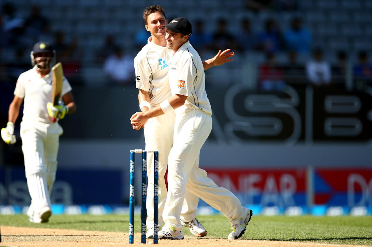 AUCKLAND, NEW ZEALAND - FEBRUARY 09: Trent Boult of New Zealand celebrates his wicket of Ravindra Jadeja of India (L) with Tim Southee (R) during day four of the First Test match between New Zealand and India at Eden Park on February 9, 2014 in Auckland, New Zealand. (Photo by Phil Walter/Getty Images)