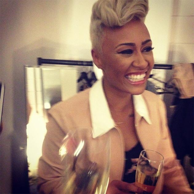 Backstage at the BRITs: Emeli Sande cracks open the champagne after walking away with Best Female and Best Album. Copyright [Emeli Sande]