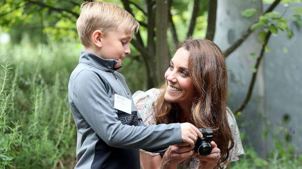 PHOTO: Catherine, Duchess of Cambridge speaks with Josh Evans at photography workshop for Action for Children, run by the Royal Photographic Society at Warren Park on June 25, 2019, in Kingston, England. (Chris Jackson/Getty Images)