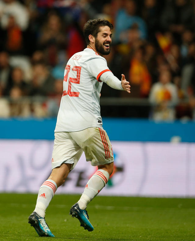 FILE - In this Tuesday, March 27, 2018 file photo, Spain's Isco Alarcon celebrates after scoring Spain's 6th goal during the international friendly soccer match between Spain and Argentina at the Wanda Metropolitano stadium in Madrid. (AP Photo/Paul White, File)