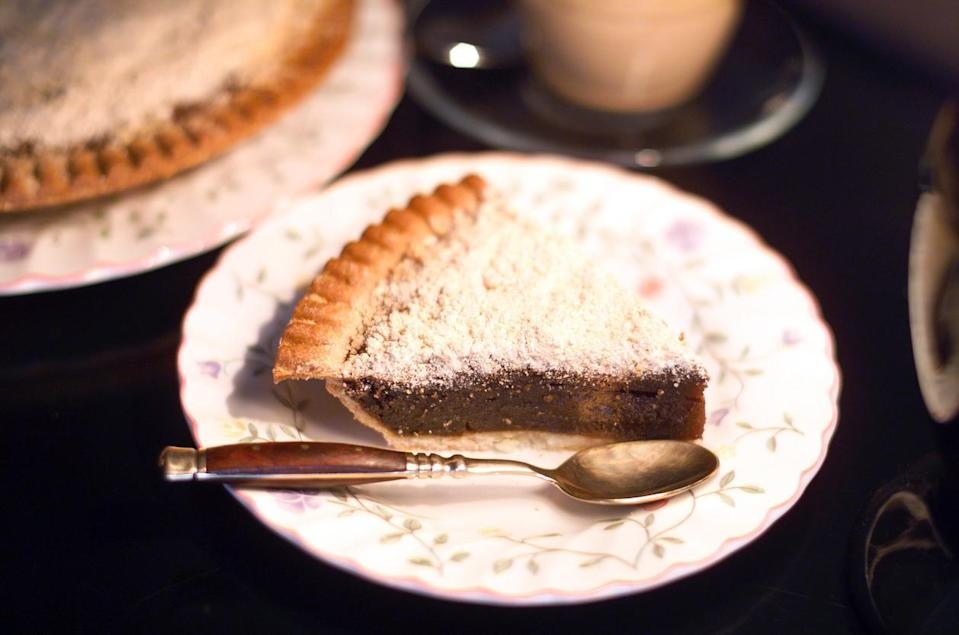 "<p>Originating with the Pennsylvania Dutch, shoofly pie gets its name from the sticky-sweet molasses in its filling that would attract flies that would have to be ""shooed"" away. The pie's dense custard is topped with crumbs and embodies the <a href=""https://www.thedailymeal.com/cook/reasons-grandma-was-best-cook?referrer=yahoo&category=beauty_food&include_utm=1&utm_medium=referral&utm_source=yahoo&utm_campaign=feed"" rel=""nofollow noopener"" target=""_blank"" data-ylk=""slk:key components of grandma's cooking"" class=""link rapid-noclick-resp"">key components of grandma's cooking</a>, like baking from scratch and using hearty ingredients.</p>"