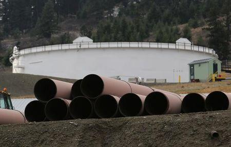 FILE PHOTO: Replacement pipe is stored near crude oil storage tanks at Kinder Morgan's Trans Mountain Pipeline terminal in Kamloops