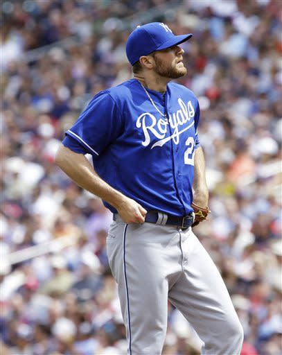 Kansas City Royals pitcher Wade Davis reacts after giving up a walk to Minnesota Twins' Chris Parmelee in the first inning of a baseball game, Saturday, June 29, 2013, in Minneapolis. (AP Photo/Jim Mone)