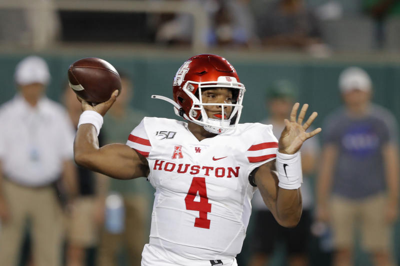 Houston quarterback D'Eriq King throws a pass during the first half of the team's NCAA college football game against Tulane in New Orleans, Thursday, Sept. 19, 2019. (AP Photo/Gerald Herbert)