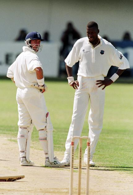 29 Jan 1998:  Alec Stewart of England and Curtly Ambrose of the West Indies discuss the state of the pitch after Stewart is hit off a length during the first morning of the First Test match at Sabina Park in Kingston, Jamaica. The match was abandoned after England players were hit 7 times in 10 overs and discussions ruled the pitch unsafe. England ended on 17 for 3 with Stewart unbeaten on 9. \ Mandatory Credit: Laurence Griffiths /Allsport