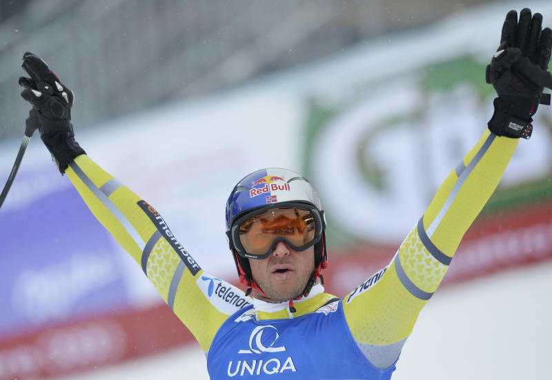 Norway's Aksel Lund Svindal celebrates after his run of the men's downhill at the Alpine skiing world championships in Schladming, Austria, Saturday, Feb. 9, 2013. (AP Photo/Kerstin Joensson)