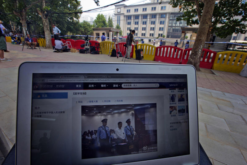 FILE - In this file photo taken Thursday Aug. 22, 2013, a website blog run by the Jinan Intermediate People's Court shows a picture of Bo Xilai attending the trial, near barricades outside the court in Jinan, in eastern China's Shandong province. The Jinan Intermediate Court released a surprising amount of details from Bo's trial, issuing regular microblog posts and same-day transcripts that included testimony, cross-examination, details of evidence and defense statements. But the partial openness is less a sign of legal reform than of the leadership's desire to lend credibility to a process believed to have a foregone conclusion: a lengthy jail sentence for Bo for dragging the ruling Communist Party into a lurid scandal of corruption, murder and betrayal. (AP Photo/Ng Han Guan, File)