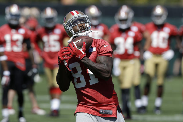San Francisco 49ers wide receiver Anquan Boldin (81) catches a pass during NFL football mini-camp in Santa Clara, Calif., Tuesday, June 17, 2014. (AP Photo/Jeff Chiu)