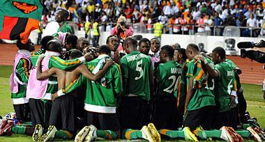 Zambian players pray after their triumph