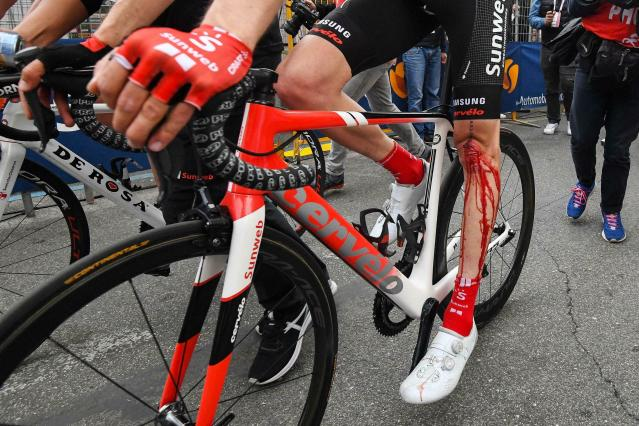 Dutch cyclist Tom Dumoulin, his left leg covered with blood following a crash, pedals past the finish line after completing the 4th stage of the Giro d'Italia, tour of Italy cycling race, from Orbetello to Frascati, Tuesday, May 14, 2019. Richard Carapaz of Ecuador sprinted to victory in the fourth stage of the Giro d'Italia on Tuesday, while Slovenian cyclist Primoz Roglic kept the overall lead after avoiding a crash toward the end of the route. (Alessandro Di Meo/ANSA via AP)