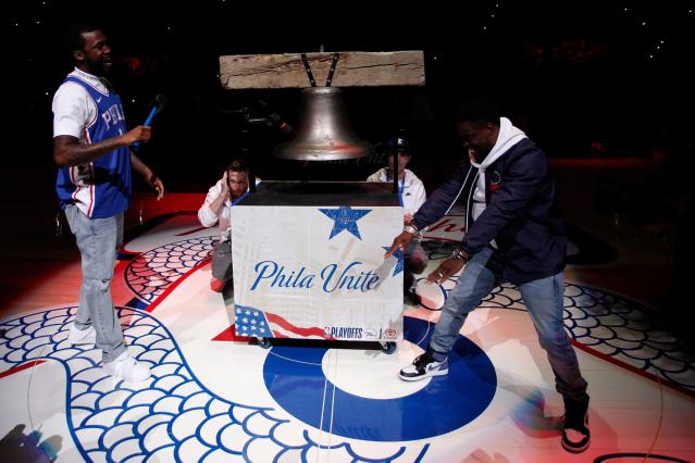 CORRECTS TO MEEK MILL NOT MEEK MILLS Rapper Meek Mill, left, comes out to ring a Liberty Bell replica with actor Kevin Hart, right, before the first half in Game 5 of a first-round NBA basketball playoff series between the Miami Heat and the Philadelphia 76ers, Tuesday, April 24, 2018, in Philadelphia. (AP Photo/Chris Szagola)
