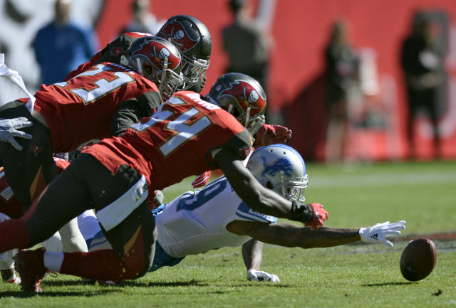 <p>Detroit Lions wide receiver Kenny Golladay (19) and Tampa Bay Buccaneers outside linebacker Lavonte David (54) and free safety Chris Conte (23) go for a fumble by Lions' Eric Ebron during the first half of an NFL football game Sunday, Dec. 10, 2017, in Tampa, Fla. David came up with the football. (AP Photo/Jason Behnken) </p>