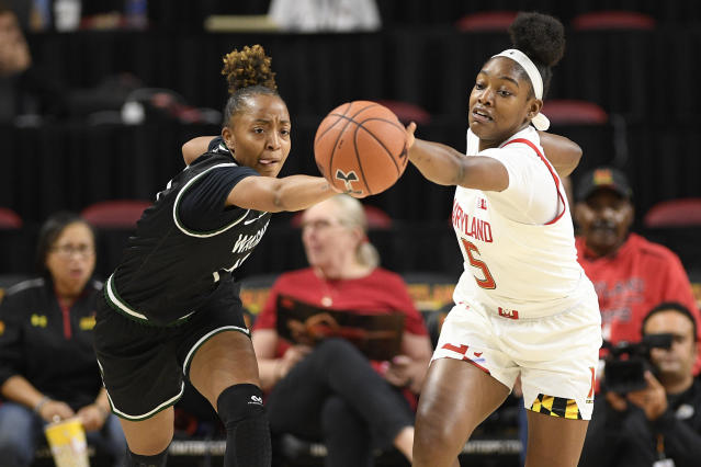 Maryland guard Kaila Charles (5) battles for the ball against Wagner forward Jordan Hobson, left, during the first half of an NCAA college basketball game, Tuesday, Nov. 5, 2019, in College Park, Md. (AP Photo/Nick Wass)