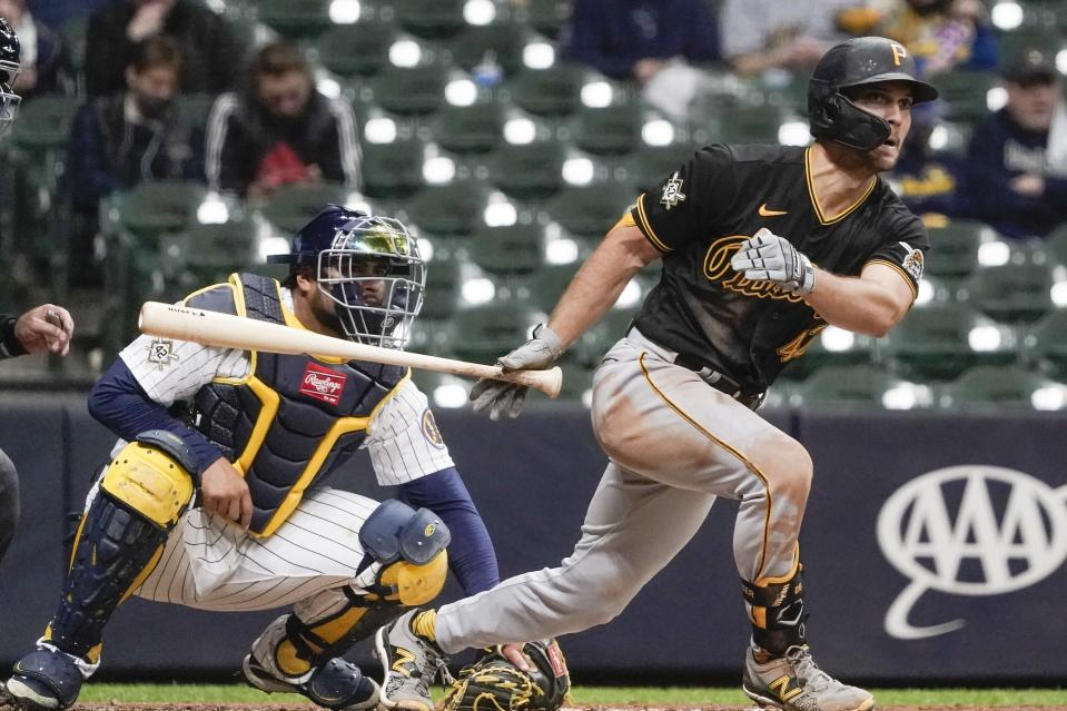 Pittsburgh Pirates' Adam Frazier hits a two-run scoring triple during the fifth inning of a baseball game against the Milwaukee Brewers Friday, April 16, 2021, in Milwaukee. (AP Photo/Morry Gash)