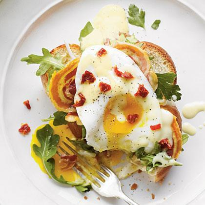 """<p>When you need a meal in a hurry, cook up Fried Egg Sandwiches. These open-faced egg sandwiches are true comfort food goodness with layers of <a href=""""https://www.myrecipes.com/how-to/cooking-questions/what-is-pancetta"""" rel=""""nofollow noopener"""" target=""""_blank"""" data-ylk=""""slk:pancetta"""" class=""""link rapid-noclick-resp"""">pancetta</a>, arugula, and fried eggs on top of <a href=""""https://www.myrecipes.com/extracrispy/challah-bread-tastes-like-a-big-hug"""" rel=""""nofollow noopener"""" target=""""_blank"""" data-ylk=""""slk:challah bread"""" class=""""link rapid-noclick-resp"""">challah bread</a> with savory hollandaise sauce spooned on top.</p>"""