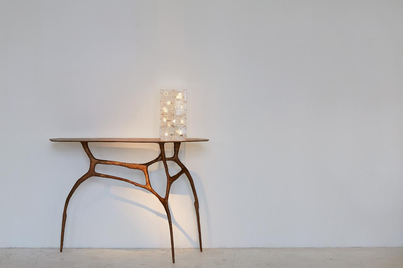 Lamp on table: Fragile Future 3.11 by Studio Drift (2012). Table: Stance Gold by Charles Trevelyan (2013).