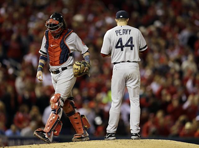 Boston Red Sox catcher Jarrod Saltalamacchia talks to starting pitcher Jake Peavy during the first inning of Game 3 of baseball's World Series against the St. Louis Cardinals Saturday, Oct. 26, 2013, in St. Louis. (AP Photo/Jeff Roberson)