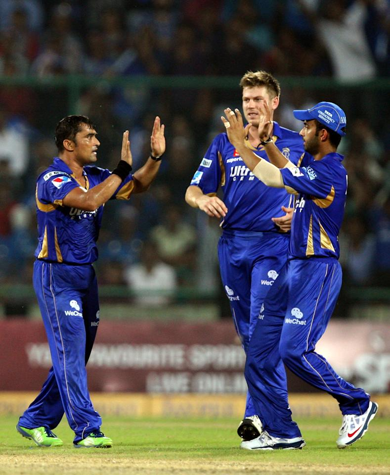 Rajasthan Royals Players celebrate after fall of a wicket during the CLT20 Final between Rajasthan Royals and Chennai Super Kings at Feroz Shah Kotla stadium, in Delhi on Oct. 6, 2013. (Photo: IANS)