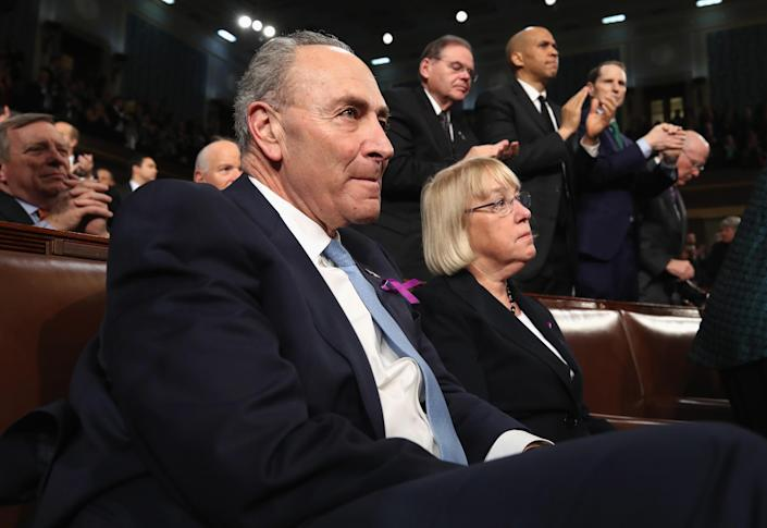 <p>Senate Minority Leader Chuck Schumer, D-N.Y., listens next to Sen. Patty Murray, D-Wash., during Trump's first State of the Union address on Jan. 30. (Photo: Win McNamee/Reuters) </p>