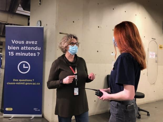 Julie Provencher, director of youth and public health services at CIUSSS de l'est de l'ile de Montreal, speaks with her 13-year-old daughter who volunteered to help out on Monday.