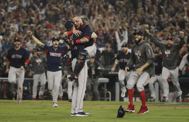 FILE - In this Oct. 28, 2018, file photo, the Boston Red Sox celebrate after Game 5 of baseball's World Series against the Los Angeles Dodgers, in Los Angeles. The goal is the same for the Red Sox in 2019: finish the season flopping around on the pitchers mound, celebrating another World Series title. (AP Photo/Jae C. Hong, File)