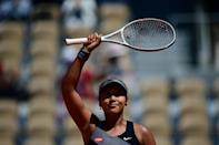 Hello, goodbye: Japan's Naomi Osaka celebrates after winning her opener against Romania's Patricia Maria Tig before eventually withdrawing from the tournament