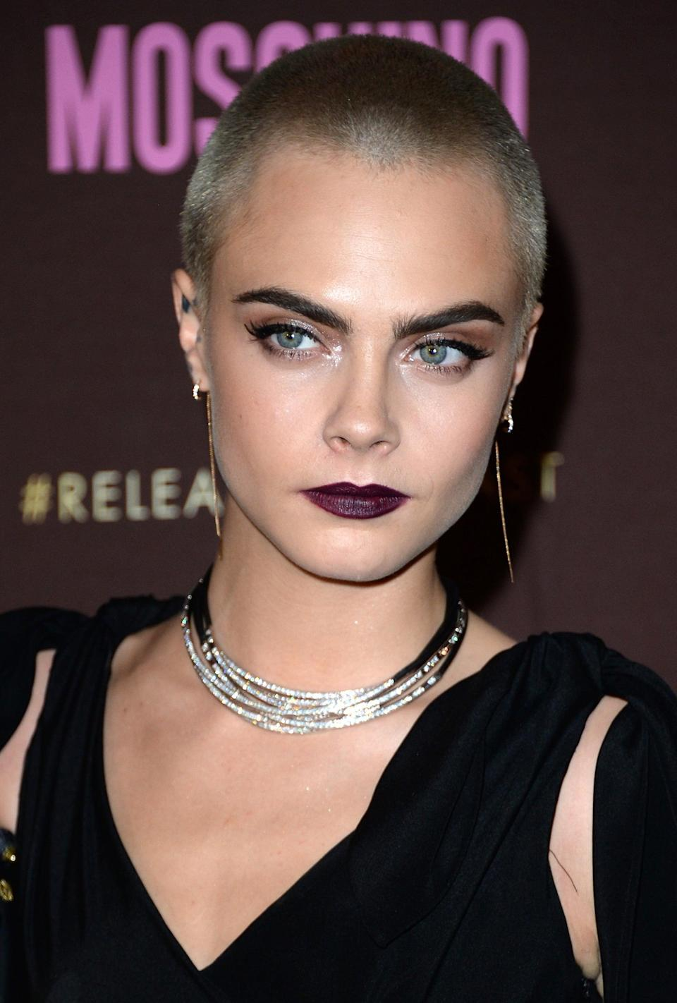 <p>Delevingne used the opportunity to put all the attention on her gorgeous features, wearing winged liner and a vampy, deep-purple lipstick, a color that made her blue eyes look even bluer. </p>