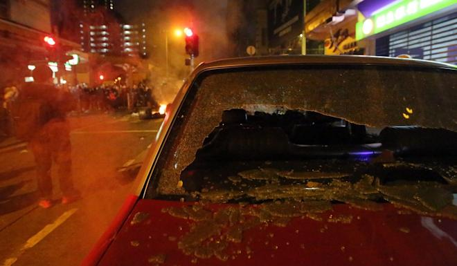 A damaged taxi is seen during clashes in Mong Kok on February 9, 2016. Photo: Edward Wong