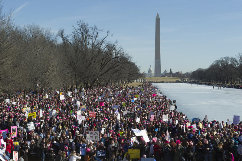 FILE - In this  Jan. 20, 2018, file photo, participants in the Women's March gather near the Lincoln Memorial in Washington. Three years after Trump took office and millions of people swarmed to the Women's March in Washington and companion marches across the country, these typically modest protests are often the most visible sign of today's Trump resistance.  (AP Photo/Cliff Owen, File)