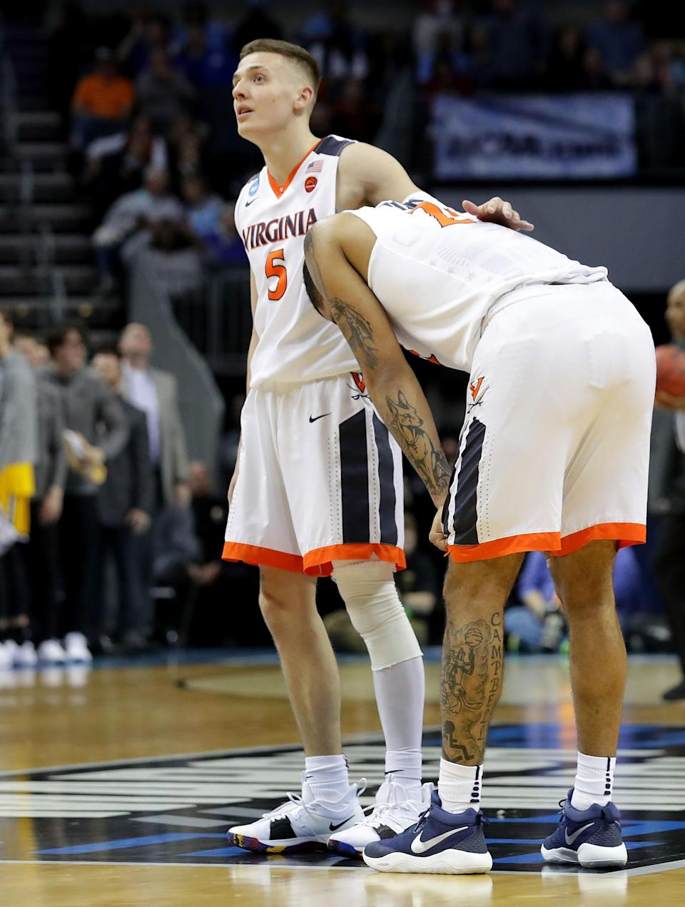 <p>Kyle Guy #5 and teammate Isaiah Wilkins #21 of the Virginia Cavaliers react to their 74-54 loss to the UMBC Retrievers during the first round of the 2018 NCAA Men's Basketball Tournament at Spectrum Center on March 16, 2018 in Charlotte, North Carolina. (Photo by Streeter Lecka/Getty Images) </p>