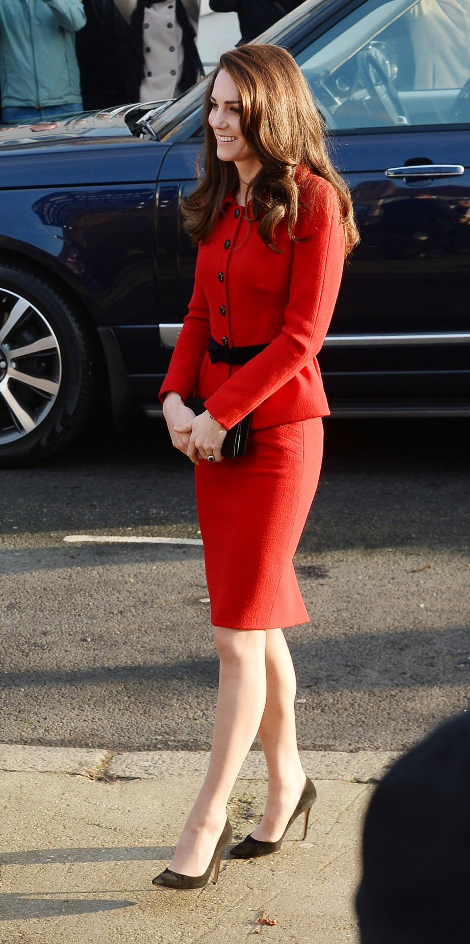 <p>Kate chose one of her favourite suits for a London school visit. Donning a bold red skirt suit by Italian designer Luisa Spagnoli, the Duchess attended a school assembly as part of her mental health initiative. Black suede pumps and a matching clutch proved to be ther perfect simple accessories.</p><p><i>[Photo: PA]</i></p>