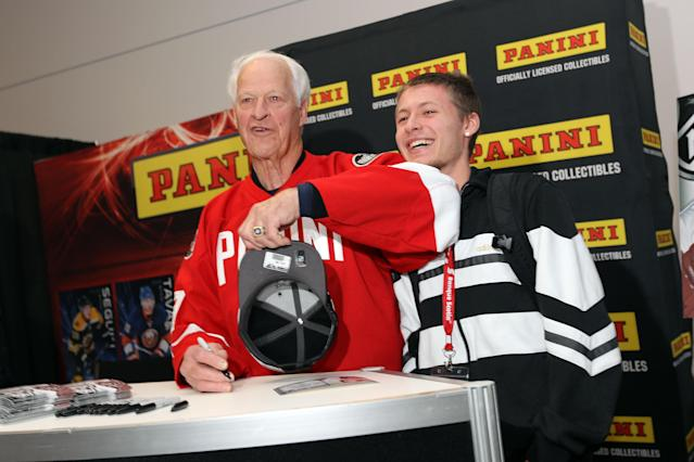 (L-R) Hockey Hall of Famer Gordie Howe poses with Bradley Galbraith of Ottawa during the NHL Fan Fair at the Ottawa Convention Centre on January 27, 2012 in Ottawa, Ontario, Canada (AFP Photo/Bruce Bennett)