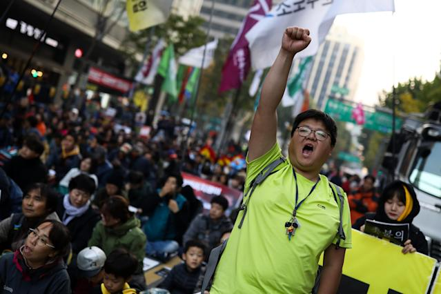 <p>A demonstrator raises a clenched fist during a protest ahead of President Donald Trump's visit near the U.S. Embassy in Seoul, South Korea, on Saturday, Nov. 4, 2017. (Photo: Seong Joon Cho/Bloomberg via Getty Images) </p>