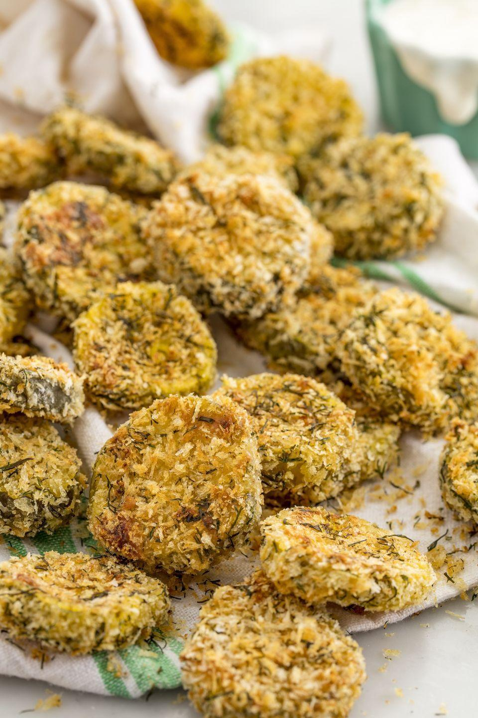 """<p>The healthier way to do fried pickles!</p><p>Get the recipe from <a href=""""https://www.delish.com/cooking/recipe-ideas/recipes/a53332/oven-fried-pickles-recipe/"""" rel=""""nofollow noopener"""" target=""""_blank"""" data-ylk=""""slk:Delish"""" class=""""link rapid-noclick-resp"""">Delish</a>. </p>"""